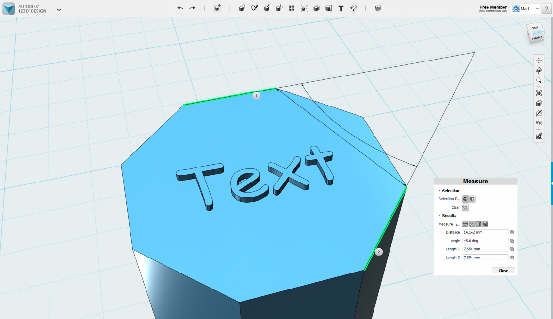 The text and measure tools in action. How 'bout some love for Comic Sans? The measure tool shows the shortest length between the two selected edges, the anlge between them and the lengths of the edges themselves.