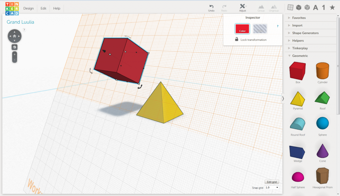 The red cube is added to the workplane along one of the sides of the yellow pyramid